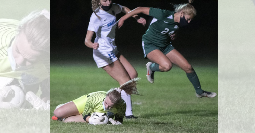 Shaker goalkeeper Gen Austin makes a save on a shot as Shenendehowa's Ella White leaps over her Tuesday, October 6, 2020. (Peter R. Barber)