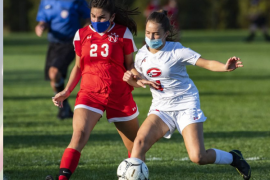 Niskayuna's Maria Tsakalakos, left, goes after the ball against Guilderland's Grace Renaud at Niskayuna High School on Tuesday. Credit: Peter Barber/Staff Photographer
