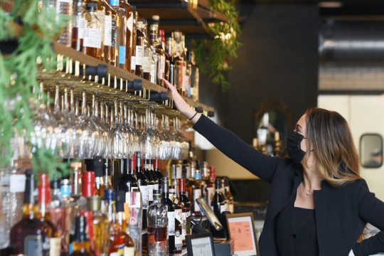 """Kaytrin and Devin Ziemann are opening their newest restaurant location """"The Nest"""" at 512 State Street in Schenectady. Kaytrin shows off their bourbons behind the bar Tuesday."""