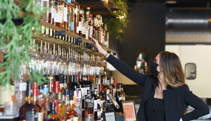 "Kaytrin and Devin Ziemann are opening their newest restaurant location ""The Nest"" at 512 State Street in Schenectady. Kaytrin shows off their bourbons behind the bar Tuesday."