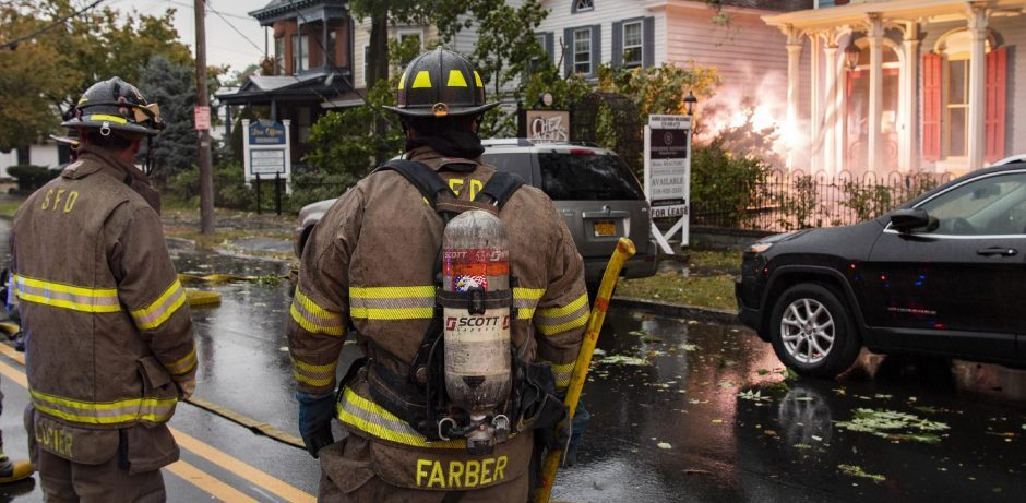 Schenectady firefighters wait for National Grid to cut the power in the 700 block of Union Street after a tree brought down primary lines causing them to arc close to the former Chez Nous restaurant on Wednesday.