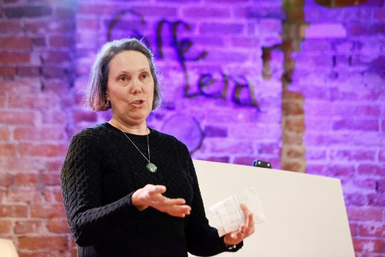 Caffe LenaExecutive Director Sarah Craig speaks on stagein a May 2019 file photo. (Erica Miller/Staff Photographer)