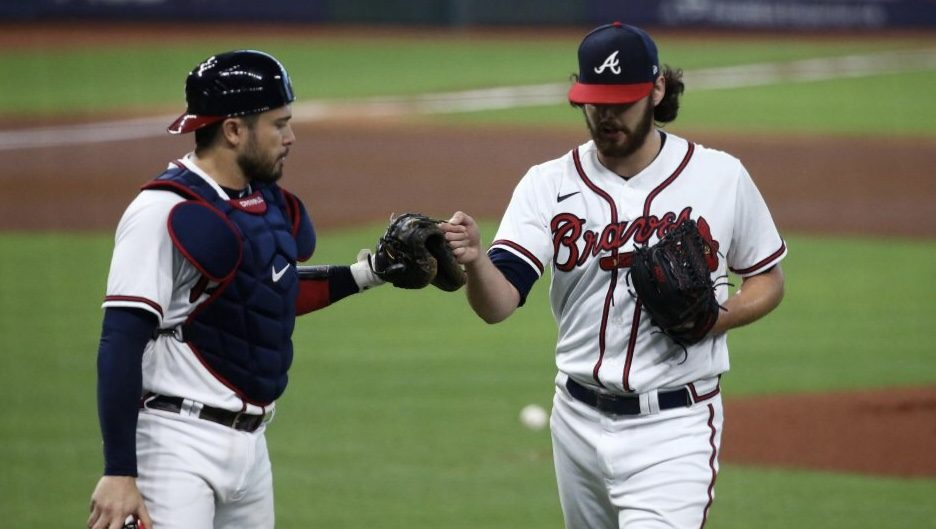 Troy Taormina/USA TODAY SportsAtlanta Braves starting pitcher Ian Anderson and catcher Travis d'Arnaud react in the second inning.