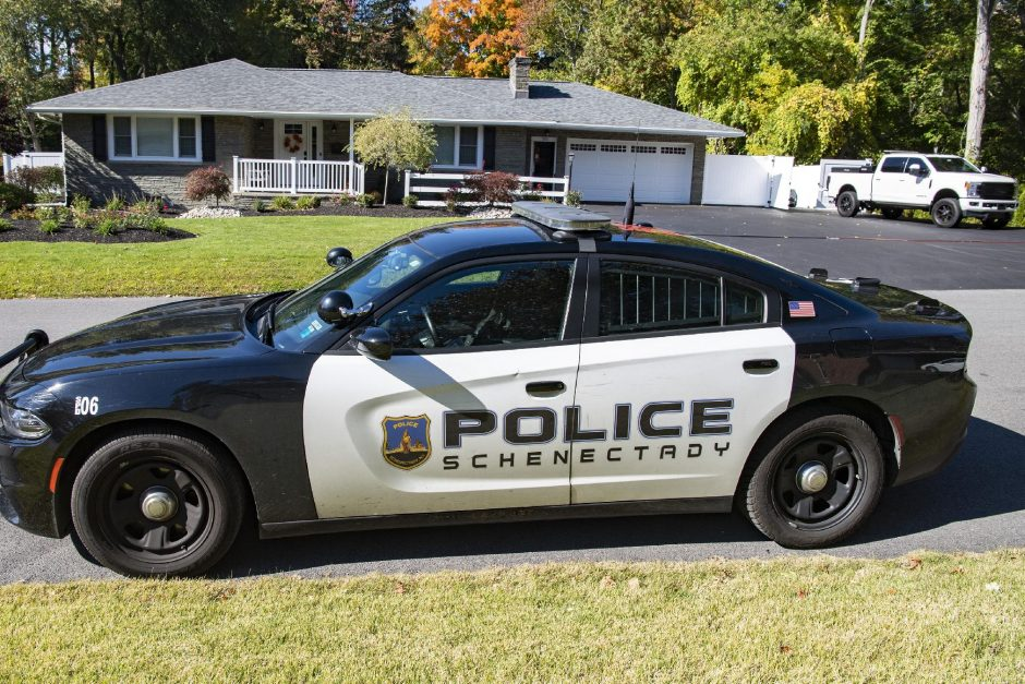 PETER R. BARBER/STAFF PHOTOGRAPHERA Schenectady police car is parked in front of David Elmendorf's house at 255 Marshall Avenue after he assaulted a private investigator Friday, October 9, 2020.