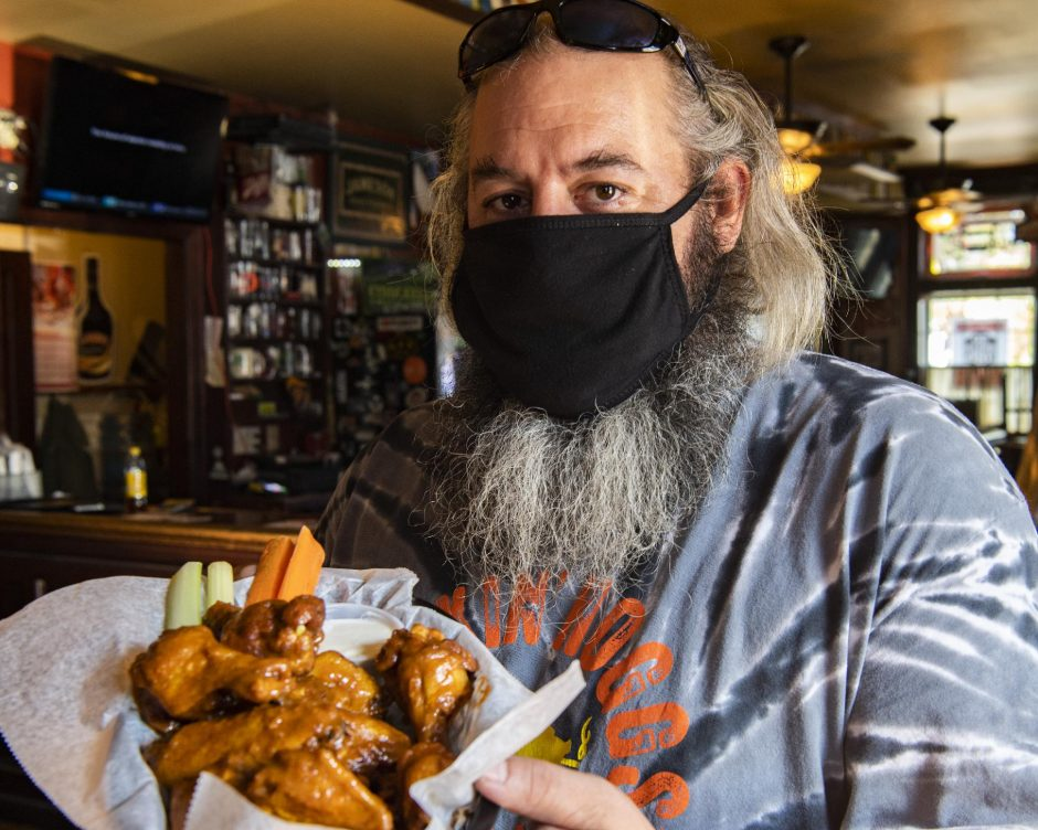 PETER R. BARBER/STAFF PHOTOGRAPHERDavid Nigriny of 20 North Broadway Tavern is pictured with a serving of spicey honey mustard chicken wings on Friday.