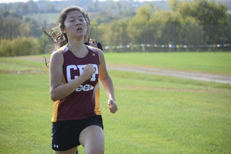 Canajoharie/Fort Plain's Sophie Xiao finishes the girls' race during a Western Athletic Conference cross country meet on Saturday at the Fort Plain Sports Complex. (Adam Shinder)