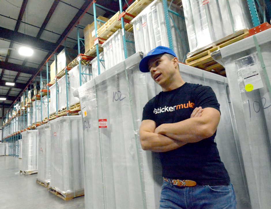 Sticker Mule owner Anthony Constantino talks about the surprise $1,000 holiday bonuses given to employees in December 2019 in this file photo. (Marc Schultz/For The Daily Gazette)