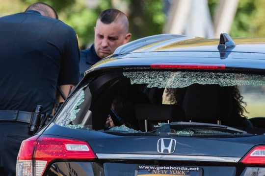 Schenectady Police officers at the damaged vehicle Monday afternoon. Credit: Peter Barber/Staff Photographer