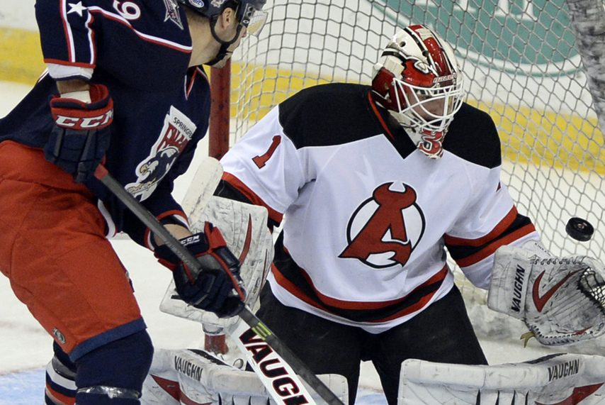 PETER R. BARBER/GAZETTE PHOTOGRAPHERKeith Kinkaid makes a save against Springfield while playing for the Albany Devils on Dec. 4, 2013. The former Union Dutchman signed with the New York Rangers this weekend.