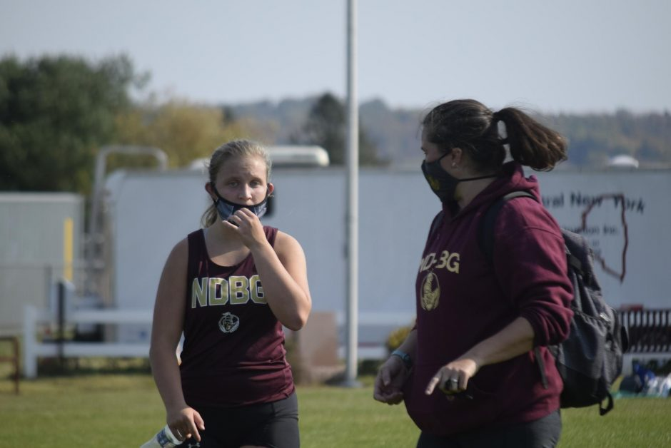 Notre Dame-Bishop Gibbons cross country runner Meaghan Kienzle (left) talks to coach Blair Hilton following her race during a Western Athletic Conference meet on Saturday in Fort Plain. (Adam Shinder/Staff Writer)