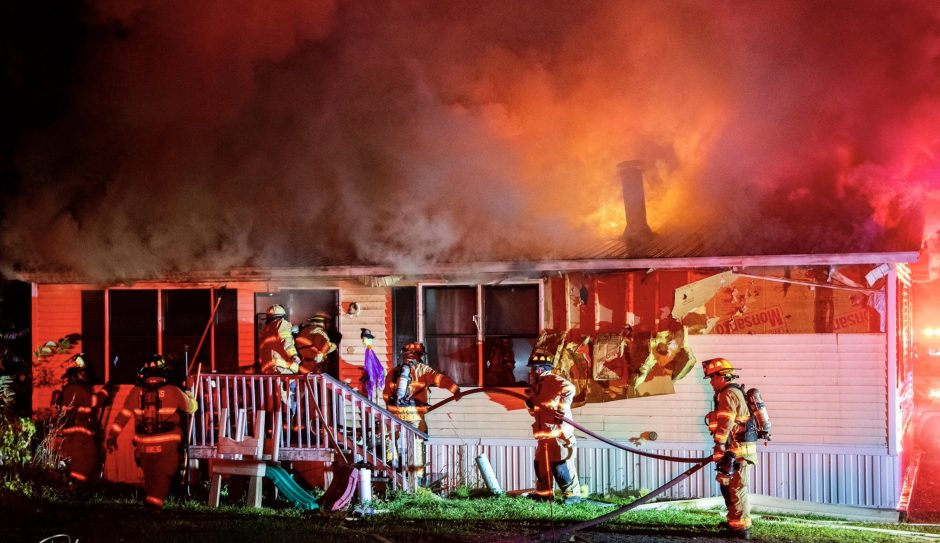Firefighters at the home Monday night. Credit: Peter Barber/Staff Photographer