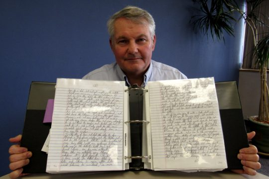 Niskayuna author Tom Swyers displays some of the letters he has received from William Blake, an inmate doing time in prison for killing a deputy sheriff in 1987. Credit: Jeff Wilkin/For the Daily Gazette