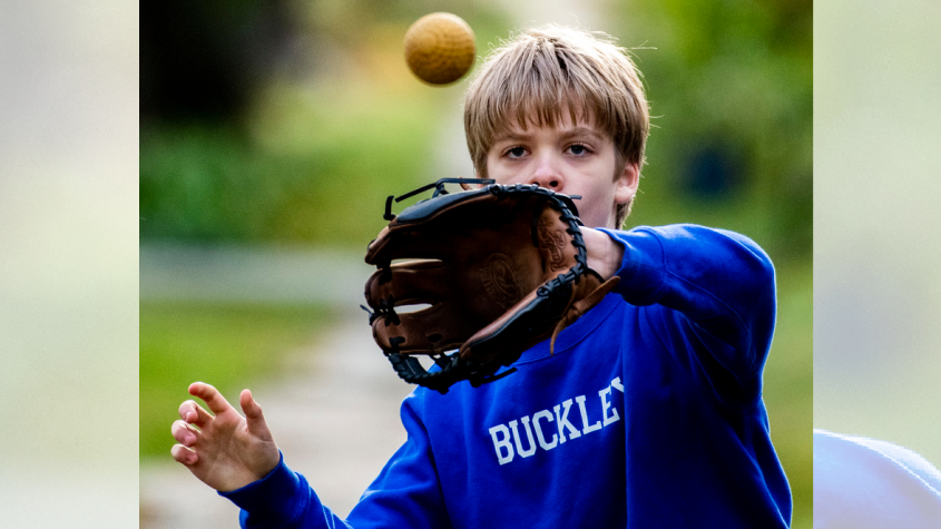 Robbie Craigmyle, III plays catch with his father Robert Craigmyle, Jr. in front of their Schenectady home Tuesday