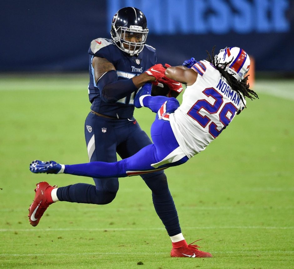 George Walker IV-USA Today NetworkTennessee Titans running back Derrick Henry tosses Buffalo Bills cornerback Josh Norman to the field during the second quarter Tuesday at Nissan Stadium.