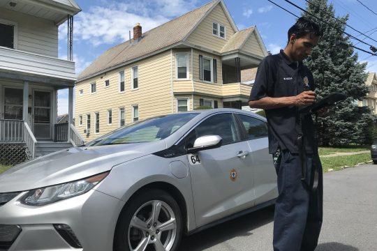 Pete DeMola/Staff WriterSchenectady code enforcement officer Nayeem Abzal responds to an assignment onSumner Avenue in Schenectady on Aug. 22, 2019.