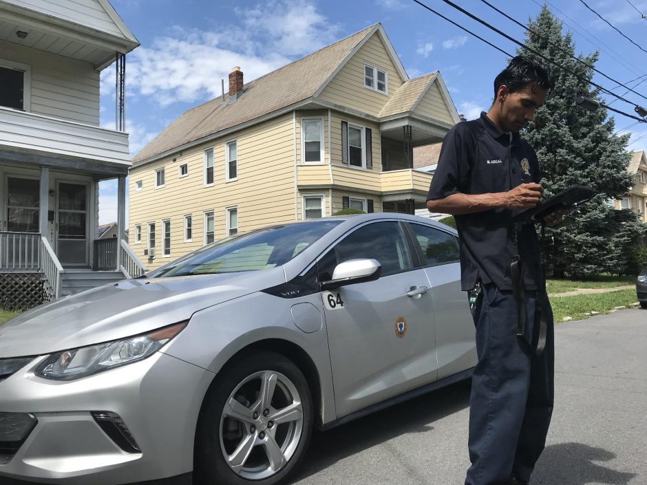 Pete DeMola/Staff WriterSchenectady code enforcement officer Nayeem Abzal responds to an assignment on Sumner Avenue in Schenectady on Aug. 22, 2019.