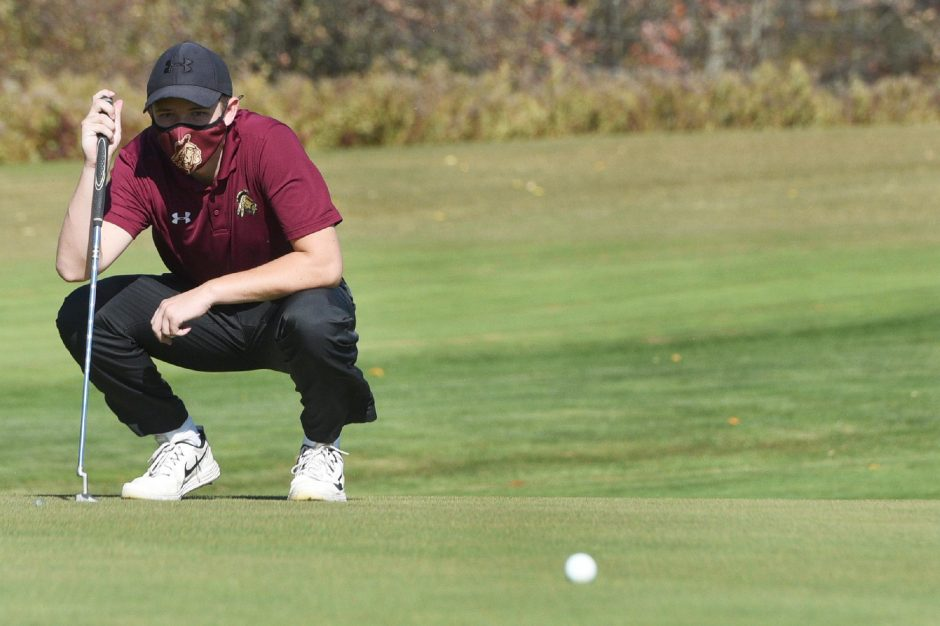 ERICA MILLER/STAFF PHOTOGRAPHER Fonda-Fultonville junior Colin Kowalski lines up a putt during the Western Athletic Conference golf championship tournament on Thursday at Hopson Hills Golf Course in Dolgeville.