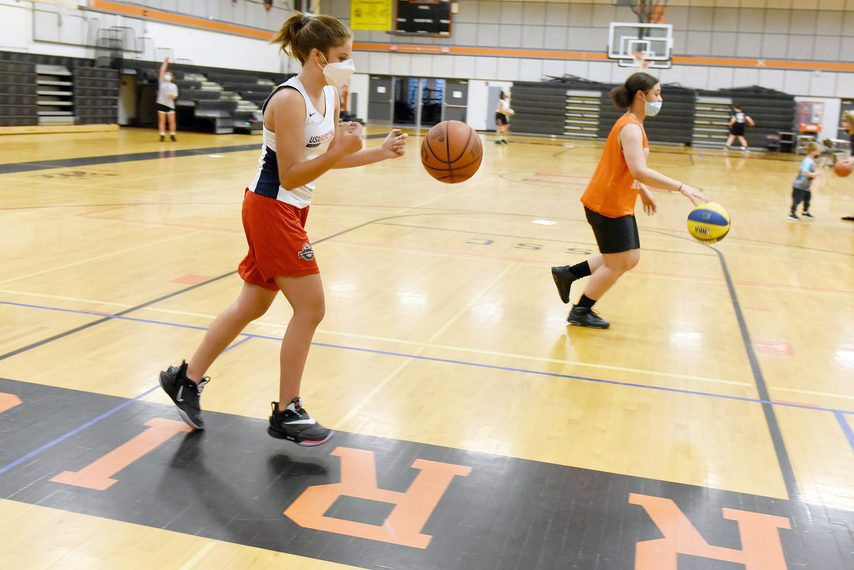 ERICA MILLER/STAFF PHOTOGRAPHER Mohonasen freshman Bella Petrocci, left, and her teammates work through a dribbling drill during practice in the high school gym on Thursday.