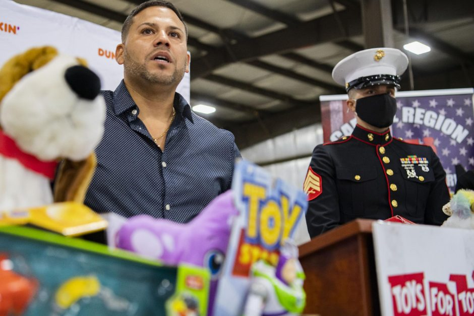 PETER R. BARBER/STAFF PHOTOGRAPHERMarine Gunnery Sgt. (Ret.) Albert Roman speaks at a news conference to announce the new Toys for Tots Drive-Thru Holiday Collection Campaign at the Marine Secure Warehouse in Clifton Park on Thursday. Marine Sgt. Ted Kleniewski listens in at right.