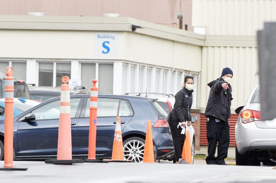 Employees work at a testing tent outside Albany Med in March.