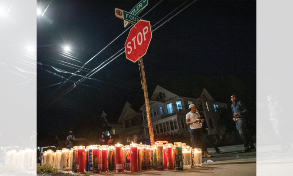 Peter R. Barber/Staff PhotographerCandles illuminate the intersection of Cutler Street and Fourth Avenue in Schenectady after a 30-year-old man was struck and killed while riding his dirt bike on Thursday.