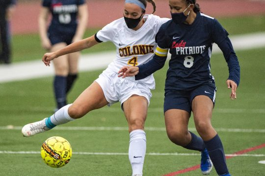 PETER R. BARBER/STAFF PHOTOGRAPHERColonie's Sofia Sanzo handles the ball next to Schenectady's Jalyssa Terry during Friday's Suburban Council girls'soccer game.