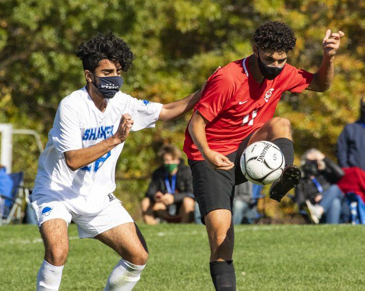 Niskayuna's Michael Pucconi clears the ball past Shaker's Muhammad Alion Saturday at Niskayuna High School. (Peter R. Barber/Staff Photographer)