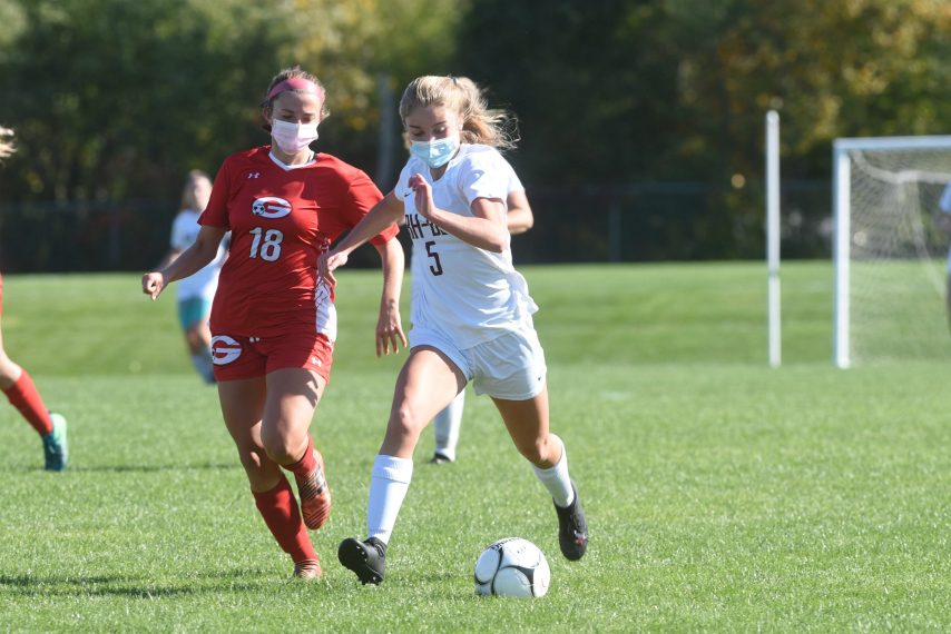 Burnt Hills-Ballston Lake sophomore midfielder Ella Blesi (5) has a step on Guilderland's Sydney Gonzalez (18) Saturday afternoon at Guilderland High School in Suburban Council competition. Stan Hudy/Staff Writer