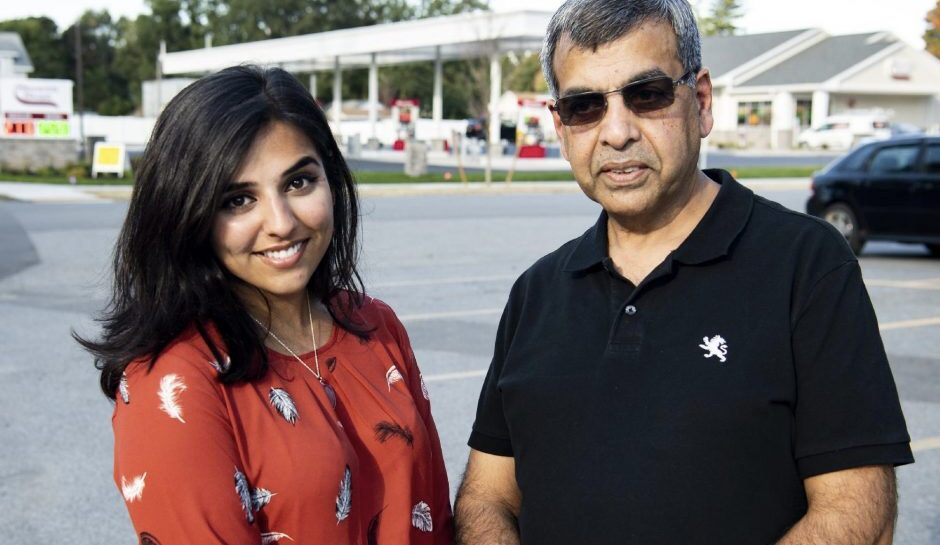 Maryam Arshad stands with her father, Arshad Butt, across from the new Stewart's Shop on Guilderland Avenue in Rotterdam on Oct. 1. (Peter R. Barber/Staff Photographer)