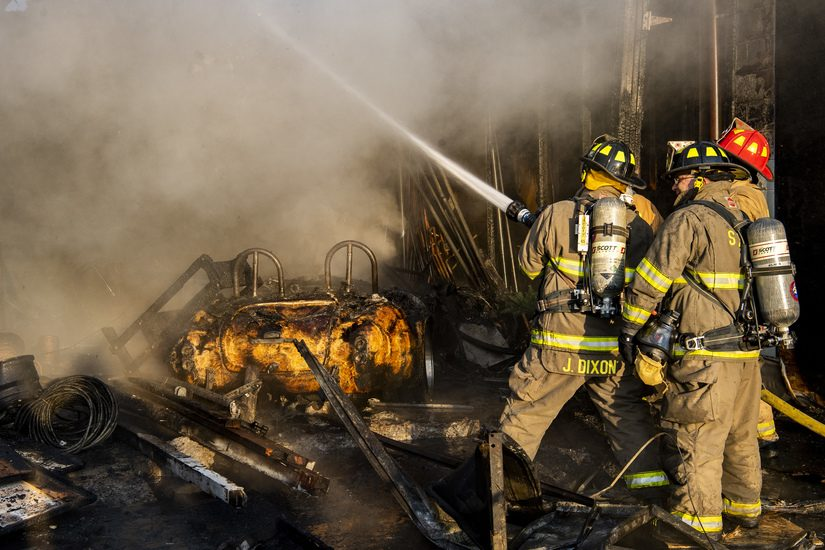 South Schenectady firefighters douse hot spots at the scene Sunday morning. Credit: PETER R. BARBER/STAFF PHOTOGRAPHER