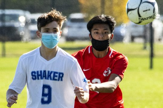 Shaker's Colin Brant and Niskayuna's Jacob Nuqui go after the ball during a boys' soccer game on Saturday at Niskayuna High School. (Peter R. Barber/Staff Photographer)