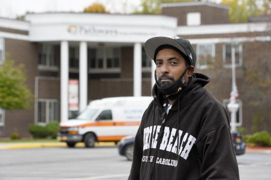 ERICA MILLER/STAFF PHOTOGRAPHER Keene Manmohan, of Schenectady, on Monday stands outside Pathway's Nursing Home on Providence Avenue in Niskayuna, where his mother is currently a resident.