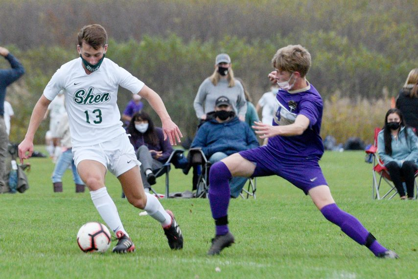 Shenendehowa's Michael Yates with the ball against CBA's Jordan Proulx during their soccer game at CBA in Colonie on Tuesday. (Erica Miller)