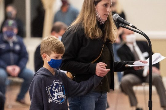 PETER R. BARBER/STAFF PHOTOGRAPHERSheila Cowieson and her son Levi, 7,ask Saratoga Springs Commissioner of Finance Michele Madigan to keep the Recreation Department open. The comments came during a public hearing in the music hallat Saratoga Springs City Hall on Tuesday.