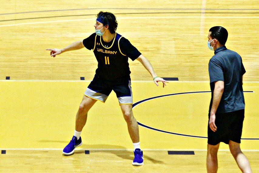 Cameron Healy, left, is shown during Wednesday's UAlbany men's basketball practice at SEFCU Arena. (Erica Miller)