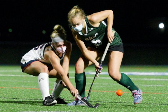 Shenendehowa's Julie Kuzmich and Saratoga Springs' Erin Fleming compete during their field hockey game in Saratoga Springs Wednesday night. (Erica Miller)