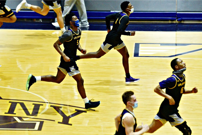 UAlbany men's basketball players run during a conditioning drill at Wednesday's practice at SEFCU Arena in Albany. (Erica Miller)