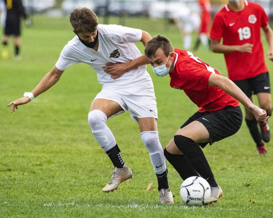 PETER R. BARBER/STAFF PHOTOGRAPHERNiskayuna's Zach Lind, left and Christian Brothers Academy's Jake Doemel fight for the ball during Thursday's SuburbanCouncil boys' soccer game.