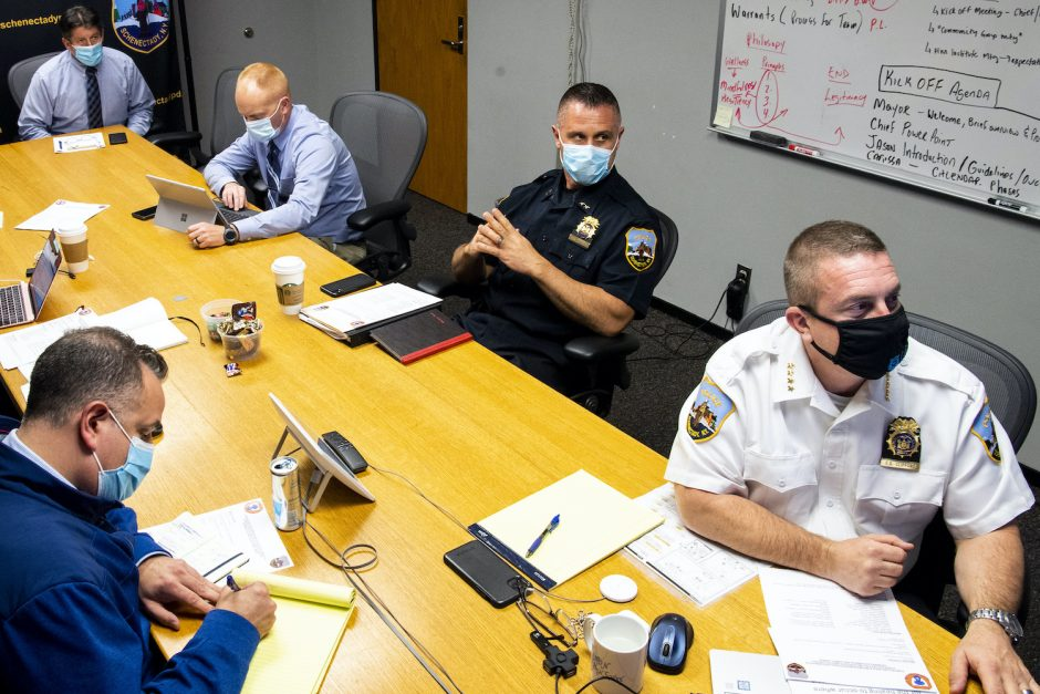 Schenectady police Chief Eric Clifford prepares his opening remarks in the 2nd of 8 Police Reform meetings at Police Headquarters Thursday, October 22, 2020. From left, are, Lt. Ryan Macherone, Assistant Chief Michael Seber, Lt. Michael McLaughlin, and Assistant Chief Daryl Mallard.