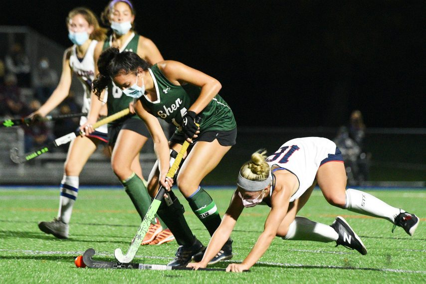Shenendehowa's Rachel Sterle with the ball against Saratoga's Erin Fleming during their field hockey game Wednesday. (Erica Miller)