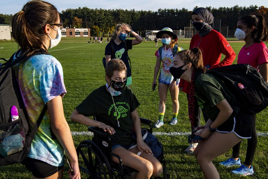 PETER R. BARBER/STAFF PHOTOGRAPHERYeva Klingbeil, center, visits with her Shenendehowa cross country teammates at practice on Friday.