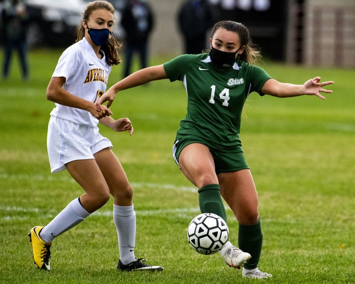 Shenendehowa's Kaylie Behan handles the ball next to Averill Park's Gabriele Geise Saturday, October 24, 2020. (Peter R. Barber/Staff Photographer)