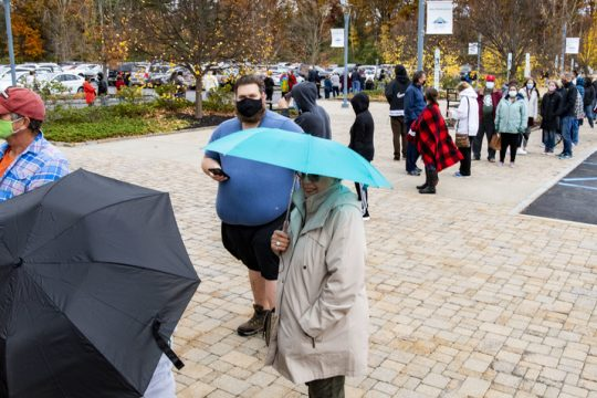 Lines of voters wait their turn to vote at the Clifton Park-Halfmoon Public Library Saturday. Credit: PETER R. BARBER/STAFF PHOTOGRAPHER