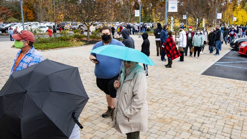 Lines of voters wait their turn to vote at the Clifton Park-Halfmoon Public Library Saturday. Credit:PETER R. BARBER/STAFF PHOTOGRAPHER