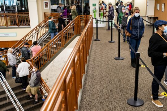 Lines of voters meander up stairways and hallways at the Clifton Park-Halfmoon  Public Library Saturday.