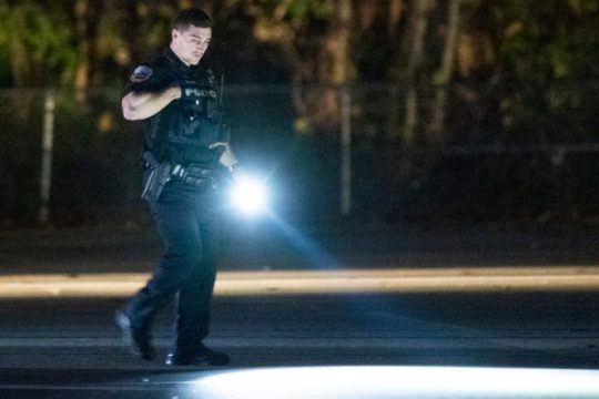 A Schenectady Police officer near the scene Sunday evening. Photo by Peter R. Barber/Staff Photographer