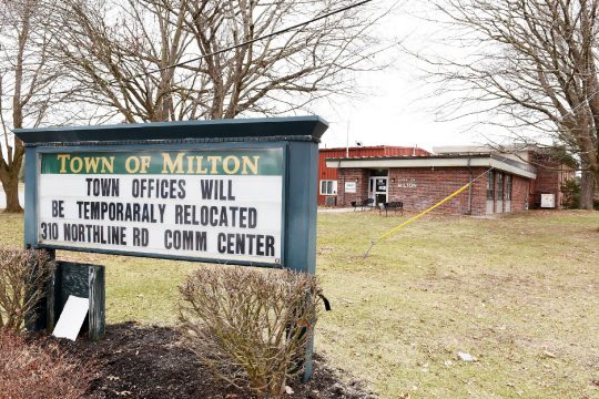 ERICA MILLER/STAFF PHOTOGRAPHER A sign for the MiltonTown Hall in April tells the public that town offices have been temporarilymoved to the MiltonCommunity Center.