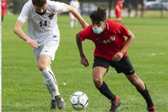 Niskayuna's Eric Romero takes the ball up field next to Christian Brothers Academy's Jack Ryan last week. (Peter R. Barber)