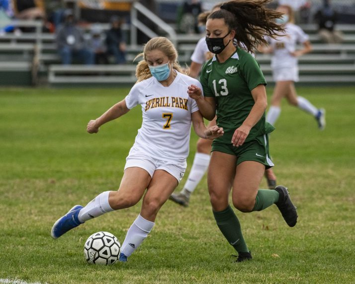 Averill Park's Francesca Morone clears the ball away from Shenendehowa's Sophia DeMura during a girls' soccer game on Saturday in Clifton Park. (Peter R. Barber/Staff Photographer)