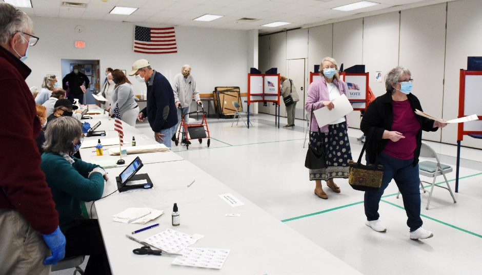 ERICA MILLER/STAFF PHOTOGRAPHER Voters cast their ballots during early voting at Glenville Senior Center in Glenville on Monday.
